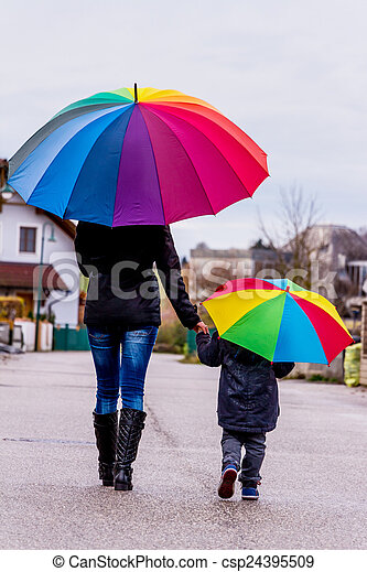 mother and child with umbrella - csp24395509
