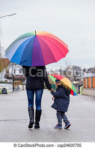 mother and child with umbrella - csp24600705