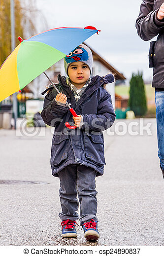 mother and child with umbrella - csp24890837