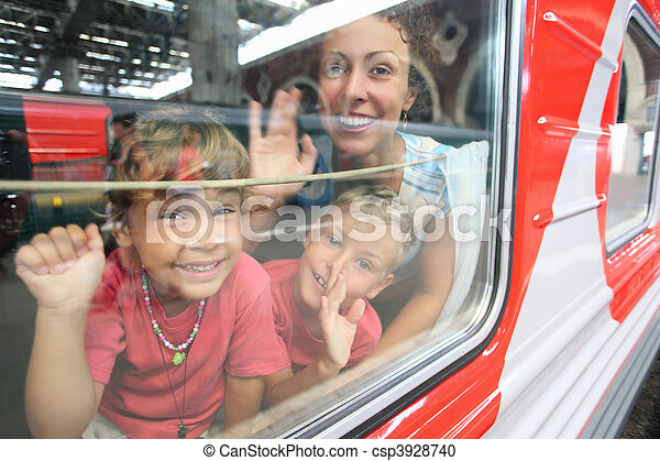 mother and children look from train window - csp3928740