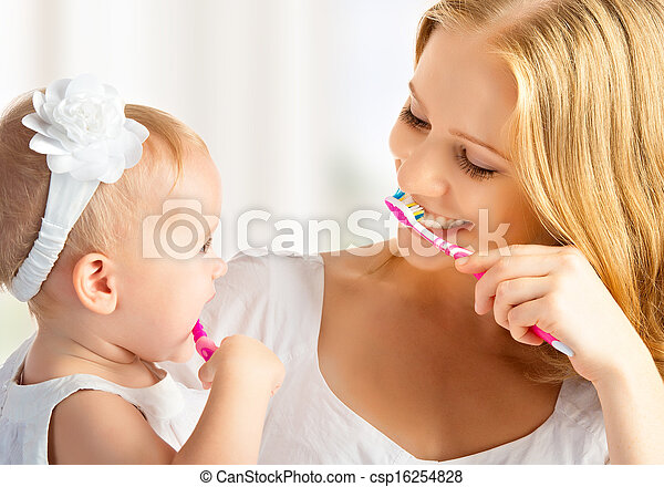 mother and daughter baby girl brushing their teeth together - csp16254828