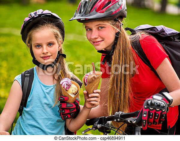 Mother and daughter bicycle. Family eating ice cream , ride bike . - csp46894911