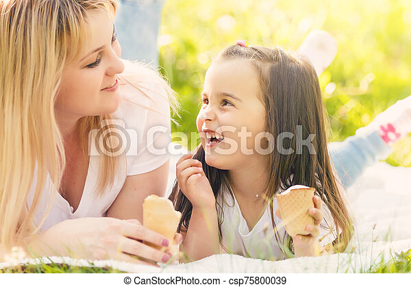 Mother and daughter eating ice-cream - csp75800039