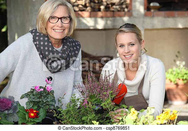 Mother and daughter gardening - csp8769851