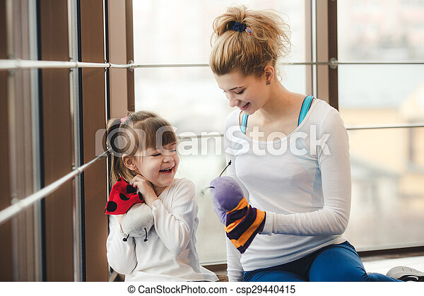 Mother and daughter have fun in the gym - csp29440415