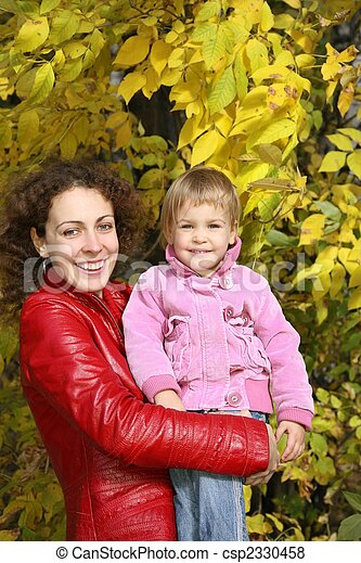 mother and daughter in the park in autumn - csp2330458