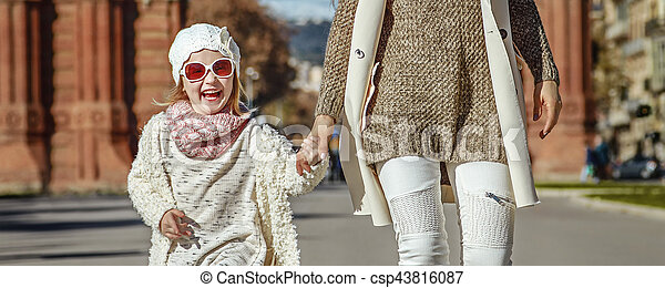 mother and daughter near Arc de Triomf in Barcelona walking - csp43816087