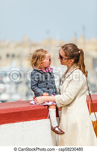 Mother and daughter portrait outdoors - csp58230480
