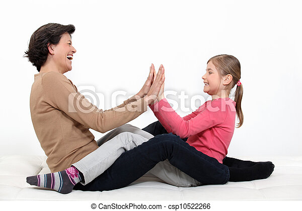 mother and daughter sharing moment of fun - csp10522266