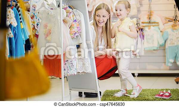 86462ef563 Mother And Daughter Try On The Costume In The Children's Clothing Store