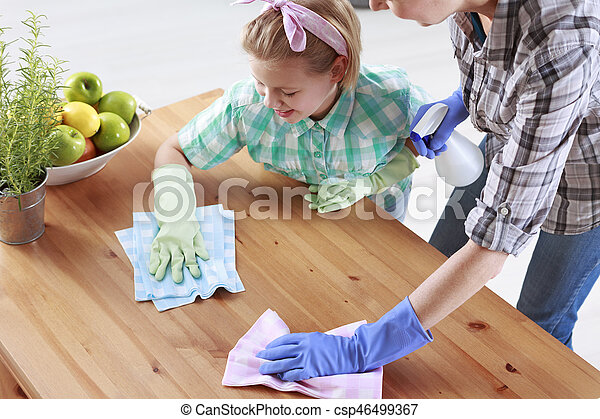 Mother and daughter wiping a table - csp46499367