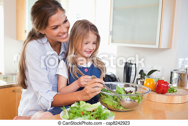 Mother and her daughter preparing a salad - csp8242923