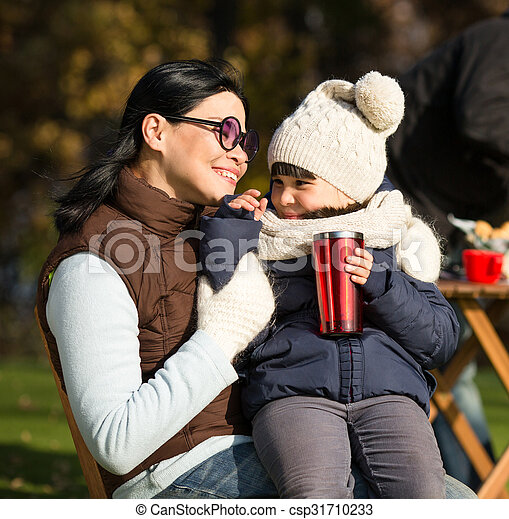 Mother and her daughter sitting all together - csp31710233