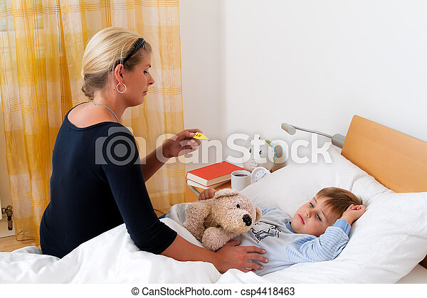 Mother and sick child in bed. Flu. Childhood diseases. - csp4418463
