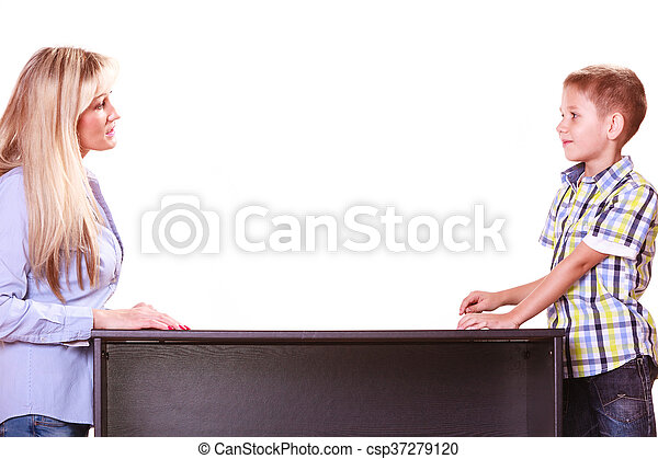 Mother and son talk and argue sit at table. - csp37279120