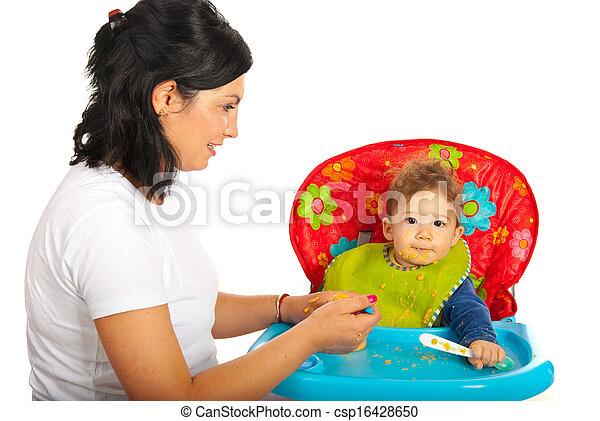 Mother feeding baby - csp16428650