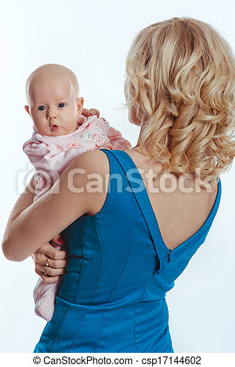 Mother holding sweet baby girl - csp17144602