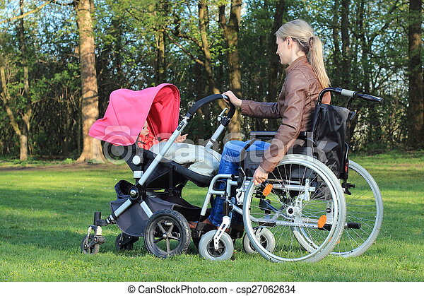 Mother in wheelchair with pram - csp27062634
