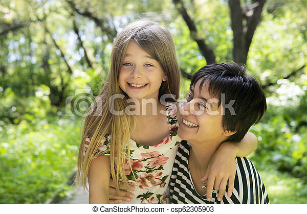 mother is playing with his daughter in the nature - csp62305903