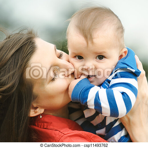 Mother kisses her son - csp11493762