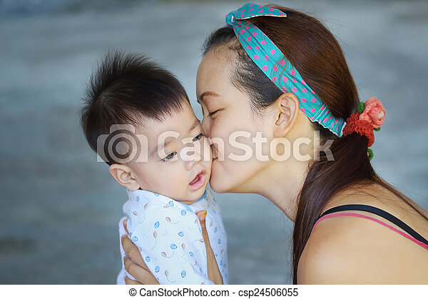 Mother kissing her baby - csp24506055