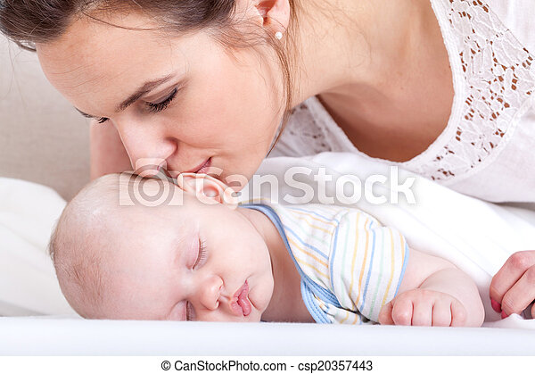 Mother kissing her baby - csp20357443