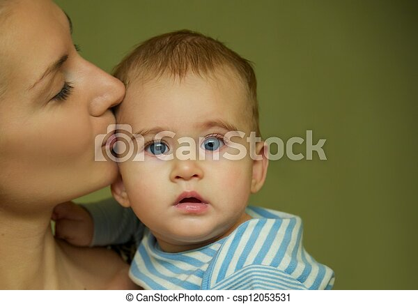 Mother kissing her baby - csp12053531