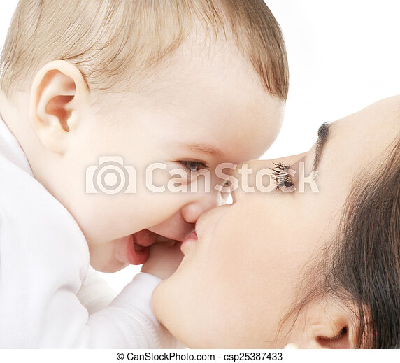 mother kissing her baby - csp25387433
