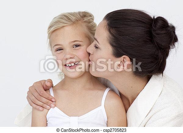 mother kissing her daughter in bathroom csp2705823