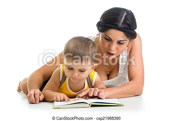 mother reading a book to her kid boy - csp21988390