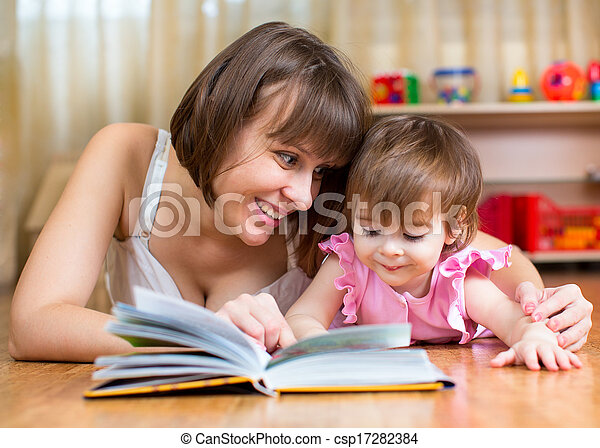 mother reading a book to kid at home - csp17282384