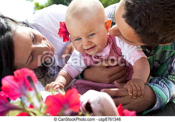 Mother, son and baby girl hugging - csp8761346