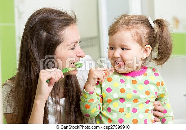 mother teaching child teeth brushing - csp27399910