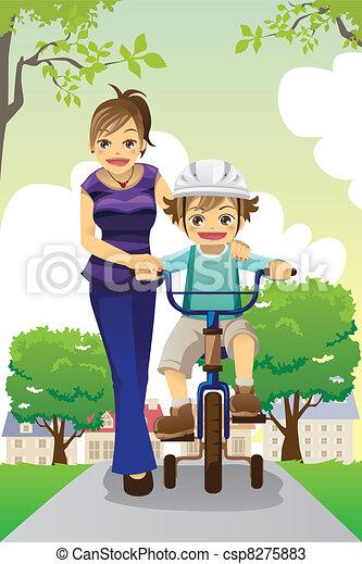 Mother teaching son biking - csp8275883