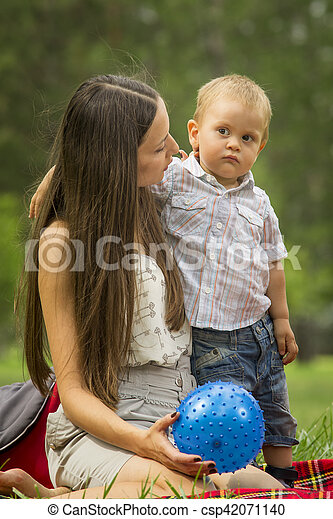 Mother with baby boy in park - csp42071140