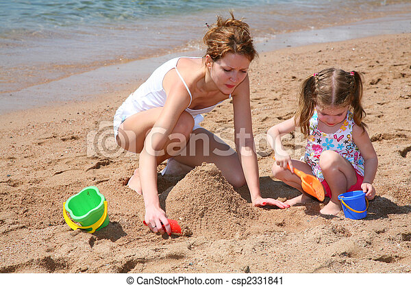 mother with baby on beach - csp2331841