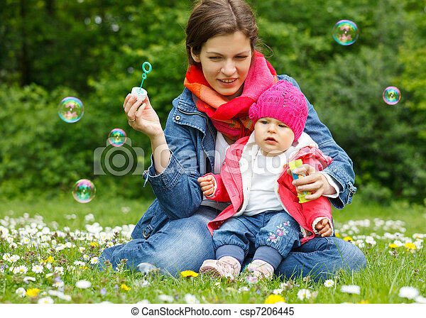 Mother with baby playing in the park - csp7206445