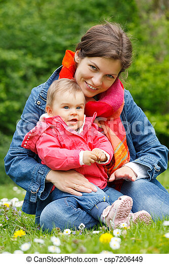 Mother with baby playing in the park - csp7206449
