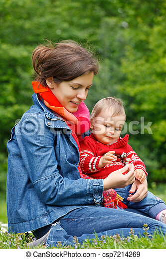 Mother with baby playing in the park - csp7214269