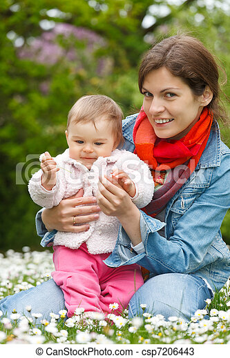 Mother with baby playing in the park - csp7206443