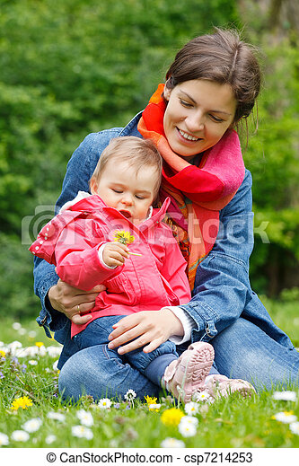 Mother with baby playing in the park - csp7214253