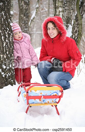 mother with child in park at winter 2 - csp2591450