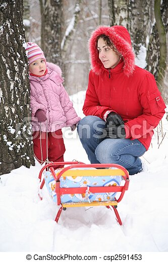 mother with child in park at winter - csp2591453