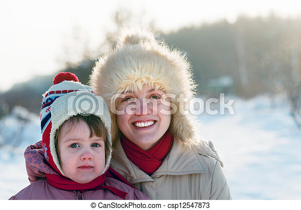 mother with child in winter park - csp12547873