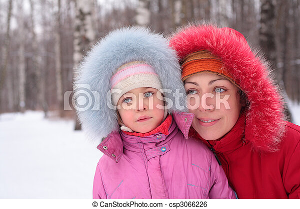Mother with child in wood in winter - csp3066226