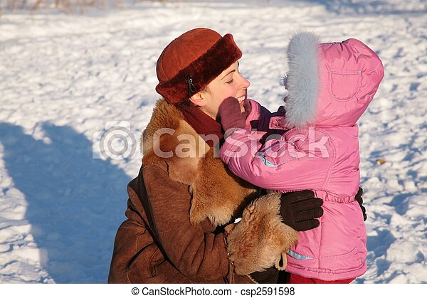 mother with child outdoor in winter - csp2591598
