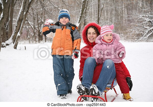 mother with children in park at winter - csp2591443