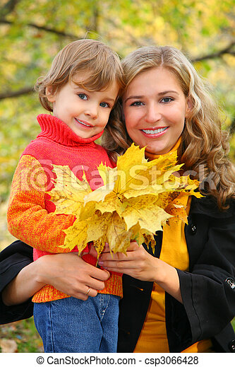 mother with daughter in autumn park - csp3066428