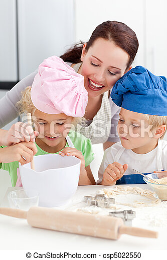 Mother with her children baking together in the kitchen - csp5022550