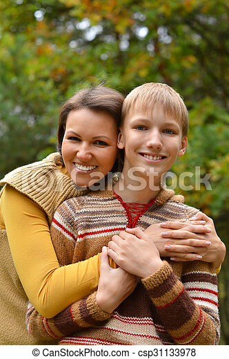 mother with son in park - csp31133978